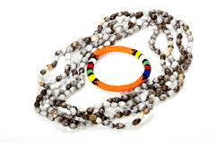 Zulu beaded necklace with bright orange armband Stock Photos