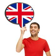 smiling man with text bubble of british flag - stock photo