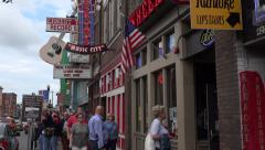 Stock Video Footage of people walk along broadway, nashville bars, tn, usa