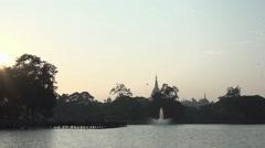 Sunset at Shwedagon Pagoda in Kandawgyi lake Stock Footage