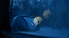 The car moves through the evening morning winter forest, view out the side windo Stock Footage