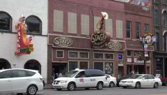 Traffic on broadway, nashville bars and neon signs, tn, usa Stock Footage