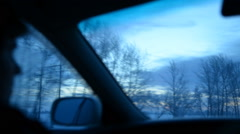 Passenger on a front seat into a car winter evening - stock footage