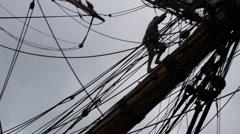 Tall ship sailor climbing onto the bowsprit Stock Footage