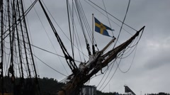 Tall ship sailor climbing down the bowsprit Stock Footage