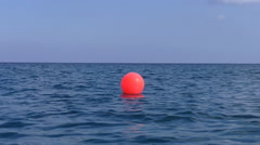 Red buoy in the sea Stock Footage