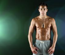Young male bodybuilder with bare muscular torso Stock Photos