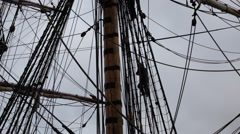 Stock Video Footage of Tall ship - two sailors are climbing down the rigging