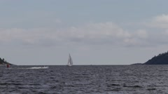 Sailing yacht crossing ocean bay Stock Footage