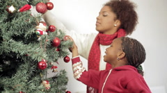 Girl decorating the christmas tree - stock footage