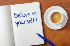 Notebook on a desk - believe in yourself Stock Photos