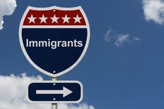 immigrants this way sign - stock photo