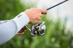 Fisherman on the river bank - stock photo