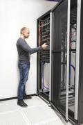 IT consultant build network rack in datacenter - stock photo