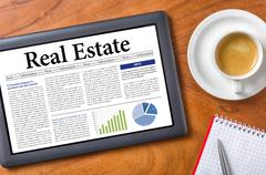 tablet on a desk - real estate - stock photo