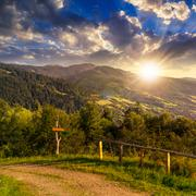 fence on hillside in mountain at sunset - stock photo