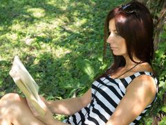 Stock Photo of reading in the summer sun