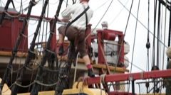 Tall ship sailor climbing into the rigging - tracking shot Stock Footage