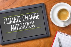 Tablet on a desk - climate change mitigation Kuvituskuvat