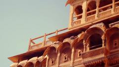 Tilt shot of Jaisalmer's elaborately sculpted sandstone havelis. Stock Footage