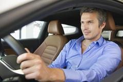 Mid adult man taking a test drive Stock Photos