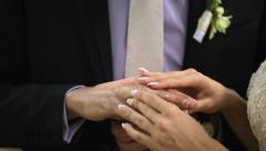 The bride and groom wear wedding rings to each other - stock footage
