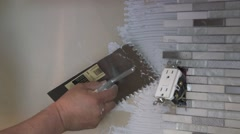 Tile setter, kitchen remodel Stock Footage