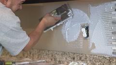 Tile setter, kitchen remodel 06 Stock Footage