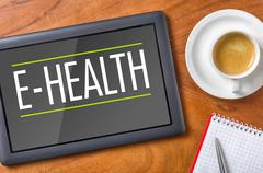 tablet on a desk - e-health - stock photo
