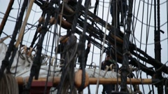 Tall ship sailors climbing in the rigging - stock footage