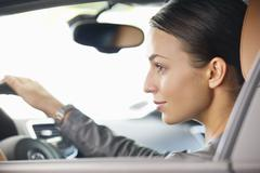 Young woman taking a test drive Stock Photos
