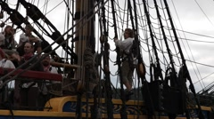Tall ship crew gathered at the railing Stock Footage