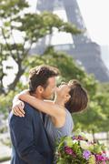 Romantic couple with the Eiffel Tower in the background, Paris, Ile-de-France, Stock Photos