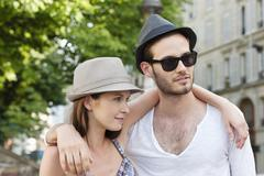 Couple with arms around each other, Paris, Ile-de-France, France Stock Photos
