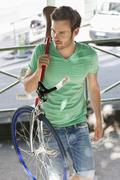 Man carrying a sports bicycle on his shoulders, Paris, Ile-de-France, France - stock photo