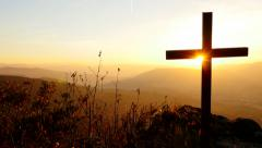 Believe in faith symbol. rest in peace. silhouette of grave cross at sunset Stock Footage