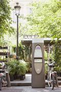 Bicycles parked near a ticket machine, Paris, Ile-de-France, France - stock photo