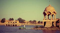 Pedal boats cross Jaisalmer's lake, India Stock Footage