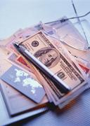 International Currency, Pen Agenda and Eyeglasses Stock Photos