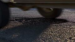 Cars Passing a Large Pothole Stock Footage