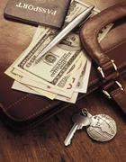 International Currency, Pen and Passport on Briefcase - stock photo