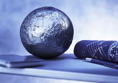 Notebook, Blueprints, Pen and Globe Pacific Rim Stock Photos