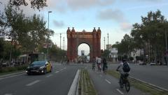 Barcelona Spain Arc De Trimof traffic bike 4K 089 Stock Footage