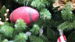 Closeup Tilt of Christmas Tree Ornaments Stock Footage