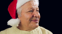 Smiling Old Man With Santa Cap Points At Xmas Gift Stock Footage