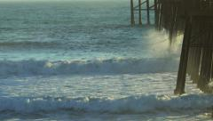 Waves Hit Pier in On Big Swell Stock Footage