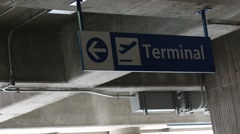 Air Terminal Direction Sign in Parking Deck Stock Footage