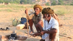 Indian men and camel attends the Pushkar Camel Mela in Rajasthan, India. Stock Footage