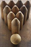 Close-up of Wooden Bowling Pins and Ball - stock photo