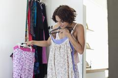 Woman trying on clothes at home Stock Photos